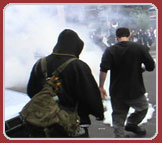 Protestors kick tear gas canister